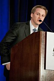 Mark Anderegg of Little Sprouts accepts their Pacesetter award at the BBJ Pacesetters 2013 Select 70 awards breakfast.