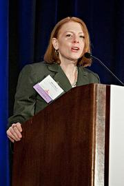 Maura Mann of The Magler Group accepts their Pacesetter award at the BBJ Pacesetters 2013 Select 70 awards breakfast.