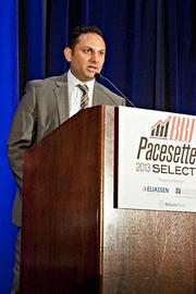 Brad Talwar of TalentBurst accepts their Pacesetter award at the BBJ Pacesetters 2013 Select 70 awards breakfast.