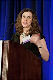 Melissa Lane of Neolane accepts their Pacesetter award at the BBJ Pacesetters 2013 Select 70 awards breakfast.