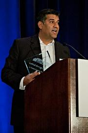 Kevin Mehra of Latitude Beverage Company accepts their Pacesetter award at the BBJ Pacesetters 2013 Select 70 awards breakfast.