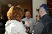 "James Blair of Brilligent Solutions encounters ""groupies"" at the 2013 Best Places to Work event."