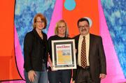 Carol Clark and Anthony Cook present the award to American Way Van and Storage.