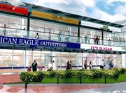 Another artist rendering of a revamped Harborplace shows off a glass roof, new signage and some possible new tenants, including an American Eagle.