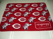 A Reds fleece blanket created by Associated Premium Corp.