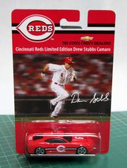 A Reds die cast car created by Associated Premium Corp.