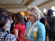 Women Who Mean Business honoree Sherry Sitarik mingles before the awards dinner.