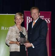 2013 Business Executive honoree Cari Coats receives her award.