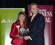 2013 Business Executive honoree Julie Young receives her award.