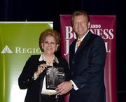 2013 Business Executive honoree Dr. Antonia Coello Novello receives her award.