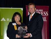 2013 Business Owner honoree Rebecca Furlow receives her award.