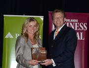 2013 Business Owner honoree Tammy Giaimo receives her award.