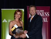 2013 Business Owner honoree Dr. Farnaz Namin-Hedayati receives her award.