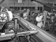 Workers pack cigarettes on a Lorillard production line in 1961.