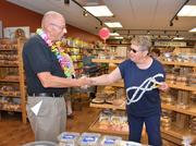 On his last day before retiring, Niskayuna Co-op general manager Donald Bisgrove shares a moment with customer Lynne Flanagan.
