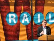Colorado Gov. John Hickenlooper speaks during opening ceremonies for RTD's  FasTracks West Rail Line from downtown Denver to Golden, which opened to the public April 26, 2013.