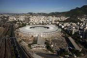 The Maracana Stadium, also known as the Mario Filho Stadium, stands in an aerial photograph taken in Rio de Janeiro, Brazil, on Wednesday. Brazil's biggest construction companies are leading a revival in overseas bond sales as investors seek out issuers that will profit from the nation's half-trillion dollars of infrastructure needs in the run-up to the World Cup and Olympic Games.