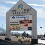 Four Hills Village, part of Riverside Plaza up for auction