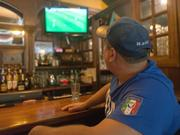 Mike Papa, owner of La Tavola, watches Italy take on Costa Rica in the World Cup from the bar at James Joyce in Harbor East.