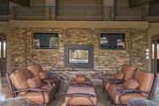 An outdoor patio area equipped with several TVs.