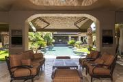 The covered patio looks out to the pool.