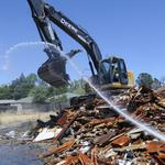 South Oak Park apartments, riddled with damage, razed by city