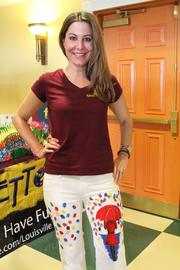 Beth Bizianes, artist at Pinot's Palette, shows off a painting design on her jeans that is offered at the business.
