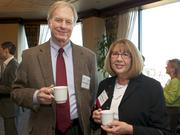 Rodger McCollum, left, and Charlotte Jacobs of AmericanWest Bank during a Business Journal Live Event at the Harbor Club in Bellevue on Thursday.