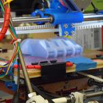 Inside the lab making 3D-printed hands (Video)