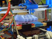 A 3-D printer at Rice University is building a plastic prosthetic hand intended to be used for children.