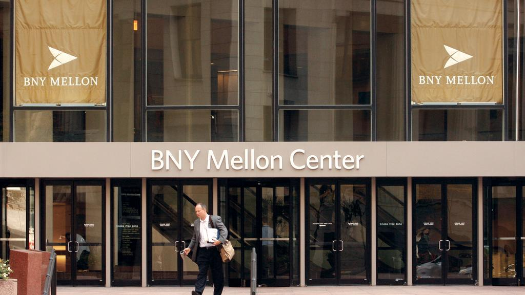 BNY Mellon continues cuts