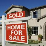 2Q home sales down, condos up; stagnant wages could hurt