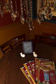 Each table has a small chalkboard where servers are free to customize promotions and messages for diners.