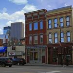 Jostens CEO <strong>Chuck</strong> <strong>Mooty</strong> buys North Loop building
