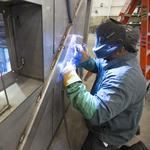 Manufacturing indicator surges in September; employers stay cautious