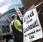 Convention Center: Carpenters protest outside while six-member crew works inside