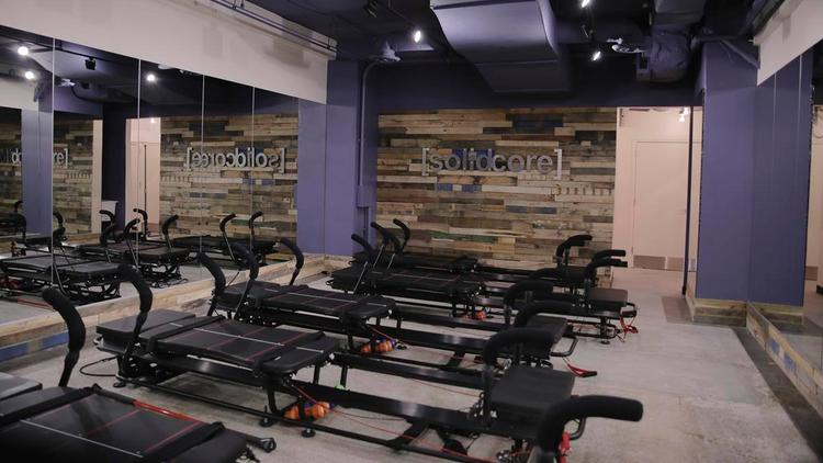 Washington, D.C.-based [solidcore] gym offers customers 50-minute classes on their specially made workout machines.
