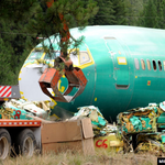 Derailed Boeing 737 fuselages crushed and baled up