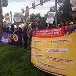 Fort Belvoir janitors strike over grievance process... and pay to drive the corporate car?