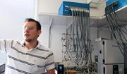 Lawrence Berkeley National Laboratory researcher Simon Lux shows off some of the battery equipment available for use by companies or institutions who sign onto the new CalCharge public-private partnership.