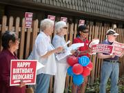Nurses and other supporters of a single-payer health care system took to the streets in 15 cities in support of Medicare for all, including in front of the Social Security Office on Arden Way in Sacramento. Nurse Shirley Toy of UC Davis Health System, wearing a red shirt and holding balloons, rallies supporters including Pamela Jones, Christina Rojas, Glenda Wertenberger, Nancy Tilcock, Carol Moss and CT Weber.