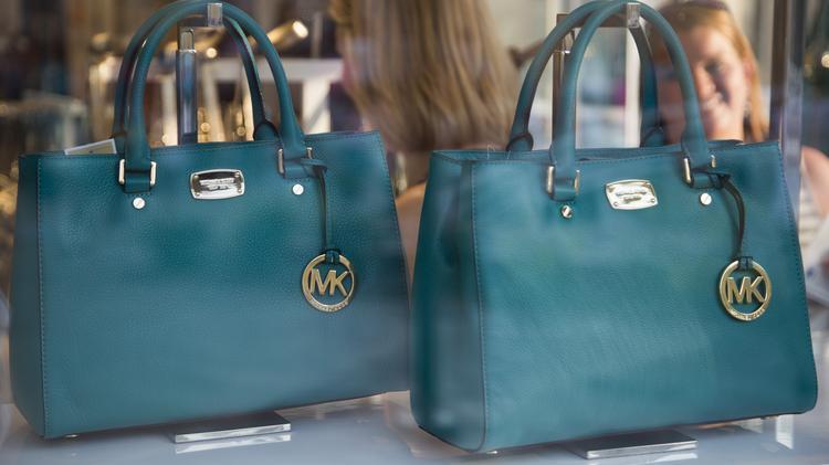 Luxury retailer Michael Kors Holdings Ltd. joining Folsom Premium ... 0afb96b9e9