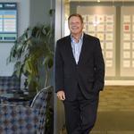 IQNavigator sells part of business, shrinks payroll