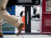 A pedestrian walks past a Gannett Co. USA Today newspaper box in Washington, D.C.