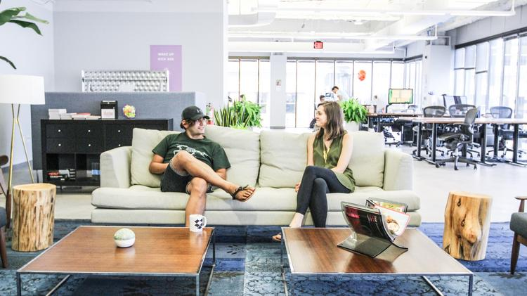 Two Dropbox Workers Kick Back And At The Companys Austin Office Lounge Austins Unemployment Rate