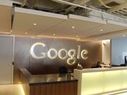 Google's logo greets visitors as they enter the company's Cambridge headquarters.