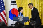 U.S. President Barack Obama, right, shakes hands with Park Geun Hye, president of South Korea, after a press conference in the East Room of the White House in Washington, D.C., on Tuesday. Obama and Park are seeking to demonstrate a solid front in the face of threats from North Korea and broader tensions in the region.