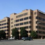 Moody's: DynCorp's dwindling cash raises default concerns