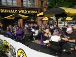 Buffalo Wild Wings franchisees side with CEO in investor fight