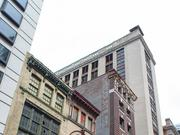 PMC Property Group had planned to demolish the three buildings along Calvert Street near the Inner Harbor and put up an apartment tower. Now it plans to renovate the buildings for its 175-unit project.